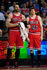 April 15, 2012; Auburn Hills, MI, USA; Chicago Bulls power forward Carlos Boozer (left) and small forward Kyle Korver (26) during a timeout in the fourth quarter against the Detroit Pistons at The Palace. Chicago won 100-94 in overtime. Mandatory Credit: Tim Fuller-US PRESSWIRE