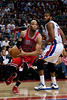 April 15, 2012; Auburn Hills, MI, USA; Chicago Bulls forward Taj Gibson (22) drives past Detroit Pistons center Greg Monroe (10) during the second quarter at The Palace. Mandatory Credit: Tim Fuller-US PRESSWIRE