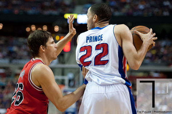 April 15, 2012; Auburn Hills, MI, USA; Chicago Bulls small forward Kyle Korver (left) guards Detroit Pistons small forward Tayshaun Prince (22) during the fourth quarter at The Palace. Chicago won 100-94 in overtime. Mandatory Credit: Tim Fuller-US PRESSWIRE