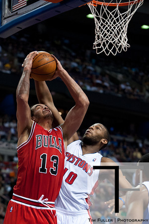 April 15, 2012; Auburn Hills, MI, USA; Detroit Pistons center Greg Monroe (10) attempts to block Chicago Bulls center Joakim Noah (13) during the second quarter at The Palace. Mandatory Credit: Tim Fuller-US PRESSWIRE