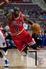 April 15, 2012; Auburn Hills, MI, USA; Chicago Bulls small forward Luol Deng (9) drives to the basket against Detroit Pistons center Greg Monroe (10) during the first quarter at The Palace. Mandatory Credit: Tim Fuller-US PRESSWIRE