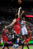 April 15, 2012; Auburn Hills, MI, USA; Chicago Bulls center Omer Asik (3) attempts to block Detroit Pistons shooting guard Ben Gordon (right) during the third quarter at The Palace. Chicago won 100-94 in overtime. Mandatory Credit: Tim Fuller-US PRESSWIRE