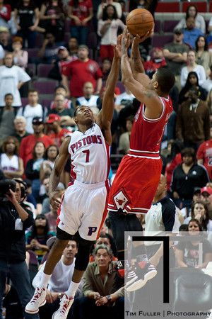 April 15, 2012; Auburn Hills, MI, USA; Detroit Pistons point guard Brandon Knight (7) attempts to block Chicago Bulls point guard Derrick Rose (right) during overtime at The Palace. Chicago won 100-94 in overtime. Mandatory Credit: Tim Fuller-US PRESSWIRE