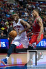April 15, 2012; Auburn Hills, MI, USA; Detroit Pistons point guard Rodney Stuckey (3) drives to the basket against Chicago Bulls point guard Derrick Rose (1) during the third quarter at  The Palace. Chicago won 100-94 in overtime. Mandatory Credit: Tim Fuller-US PRESSWIRE
