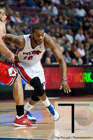 April 15, 2012; Auburn Hills, MI, USA; Detroit Pistons center Greg Monroe (10) drives to the basket during the fourth quarter against the Chicago Bulls at The Palace. Chicago won 100-94 in overtime. Mandatory Credit: Tim Fuller-US PRESSWIRE