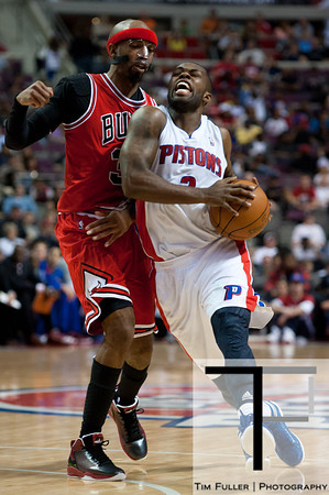 April 15, 2012; Auburn Hills, MI, USA; Detroit Pistons point guard Rodney Stuckey (3) drives to the basket against Chicago Bulls shooting guard Richard Hamilton (32) during the third quarter at The Palace. Chicago won 100-94 in overtime. Mandatory Credit: Tim Fuller-US PRESSWIRE