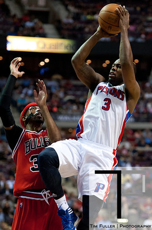 April 15, 2012; Auburn Hills, MI, USA; Detroit Pistons point guard Rodney Stuckey (3) puts up a shot over Chicago Bulls shooting guard Richard Hamilton (32) during the third quarter at The Palace. Chicago won 100-94 in overtime. Mandatory Credit: Tim Fuller-US PRESSWIRE