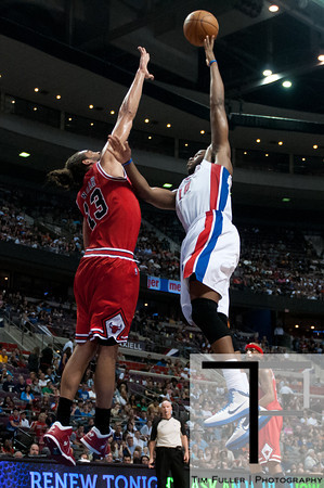 April 15, 2012; Auburn Hills, MI, USA; Chicago Bulls center Joakim Noah (left) attempts to block Detroit Pistons center Greg Monroe (right) during the third quarter at The Palace. Chicago won 100-94 in overtime. Mandatory Credit: Tim Fuller-US PRESSWIRE