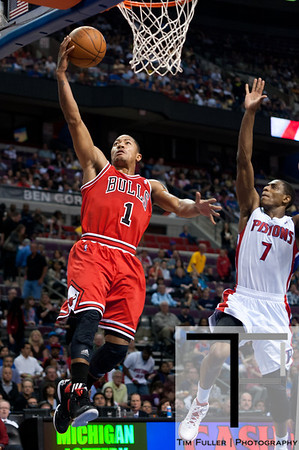 April 15, 2012; Auburn Hills, MI, USA; Chicago Bulls point guard Derrick Rose (1) makes a lay up as Detroit Pistons point guard Brandon Knight (7) follows behind during the first quarter at The Palace. Mandatory Credit: Tim Fuller-US PRESSWIRE