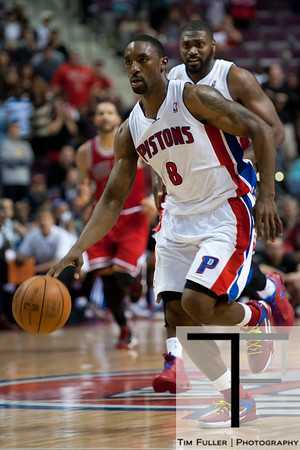 April 15, 2012; Auburn Hills, MI, USA; Detroit Pistons shooting guard Ben Gordon (8) brings the ball up court during overtime against the Chicago Bulls at The Palace. Chicago won 100-94 in overtime. Mandatory Credit: Tim Fuller-US PRESSWIRE