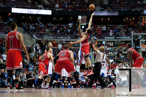 April 15, 2012; Auburn Hills, MI, USA; Chicago Bulls center Joakim Noah (13) and Detroit Pistons center Greg Monroe (10) jump during a jump ball in overtime at The Palace. Chicago won 100-94 in overtime. Mandatory Credit: Tim Fuller-US PRESSWIRE