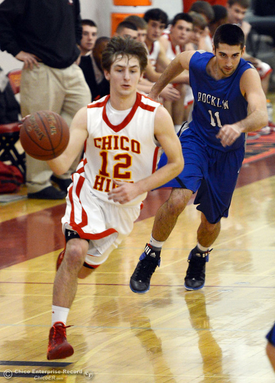 . Chico High\'s #12 Sterling Winter (left) dribbles against Rocklin High\'s #11 Tyler Chimirusti (right) in the second quarter of their boys basketball game at CHS Tuesday, January 7, 2014 in Chico, Calif.  (Jason Halley/Chico Enterprise-Record)