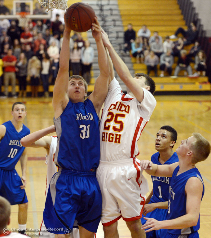. Chico High\'s #25 Thomas McNairn (right) attempts to rebound against Rocklin High\'s #30 Mark Wille (left) in the second quarter of their boys basketball game at CHS Tuesday, January 7, 2014 in Chico, Calif.  (Jason Halley/Chico Enterprise-Record)
