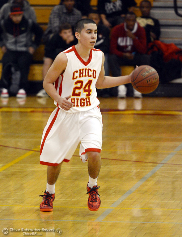 . Chico High\'s #24 Angel Roldan dribbles against Rocklin High in the second quarter of their boys basketball game at CHS Tuesday, January 7, 2014 in Chico, Calif.  (Jason Halley/Chico Enterprise-Record)
