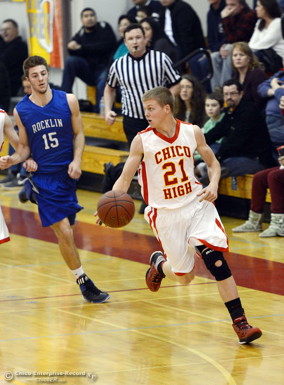. Chico High\'s #21 Hunter Mootz (right) dribbles against Rocklin High\'s #15 Vinnie Safin (left) in the second quarter of their boys basketball game at CHS Tuesday, January 7, 2014 in Chico, Calif.  (Jason Halley/Chico Enterprise-Record)