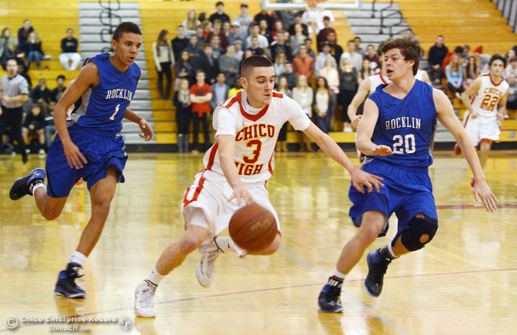 . Chico High\'s #3 Myles Lawing (center) dribbles against Rocklin High\'s #1 Seth Bradley (left) and #20 Jake Toto (right) in the second quarter of their boys basketball game at CHS Tuesday, January 7, 2014 in Chico, Calif.  (Jason Halley/Chico Enterprise-Record)