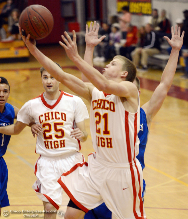 . Chico High\'s #21 Hunter Mootz (front) goes up for a shot against Rocklin High in the second quarter of their boys basketball game at CHS Tuesday, January 7, 2014 in Chico, Calif.  (Jason Halley/Chico Enterprise-Record)