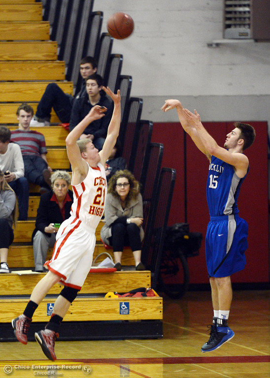 . Chico High\'s #21 Hunter Mootz (left) attempts to block against Rocklin High\'s #15 Vinnie Safin (right) in the second quarter of their boys basketball game at CHS Tuesday, January 7, 2014 in Chico, Calif.  (Jason Halley/Chico Enterprise-Record)