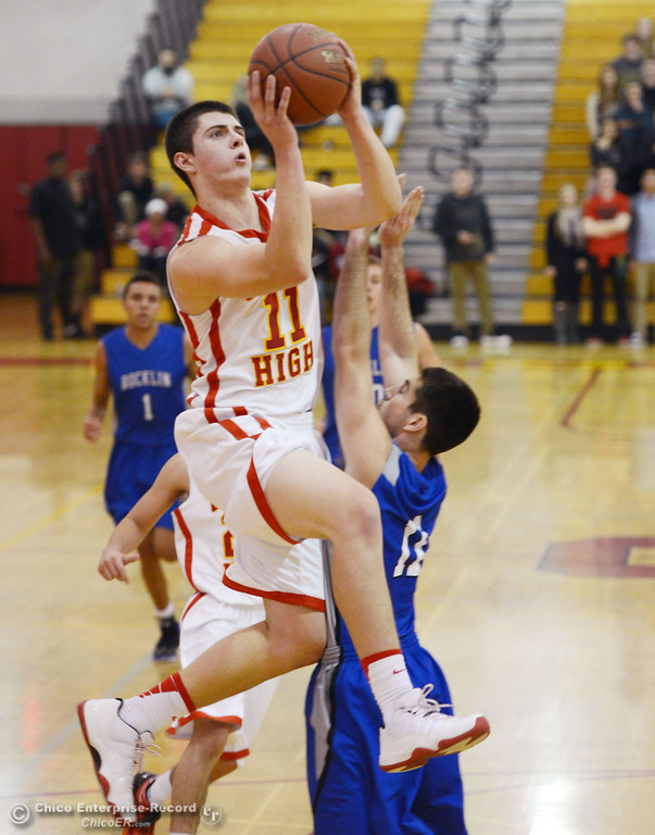 . Chico High\'s #11 Clayton Welch (left) goes up for a shot against Rocklin High\'s #11 Tyler Chimirusti (right) in the second quarter of their boys basketball game at CHS Tuesday, January 7, 2014 in Chico, Calif.  (Jason Halley/Chico Enterprise-Record)