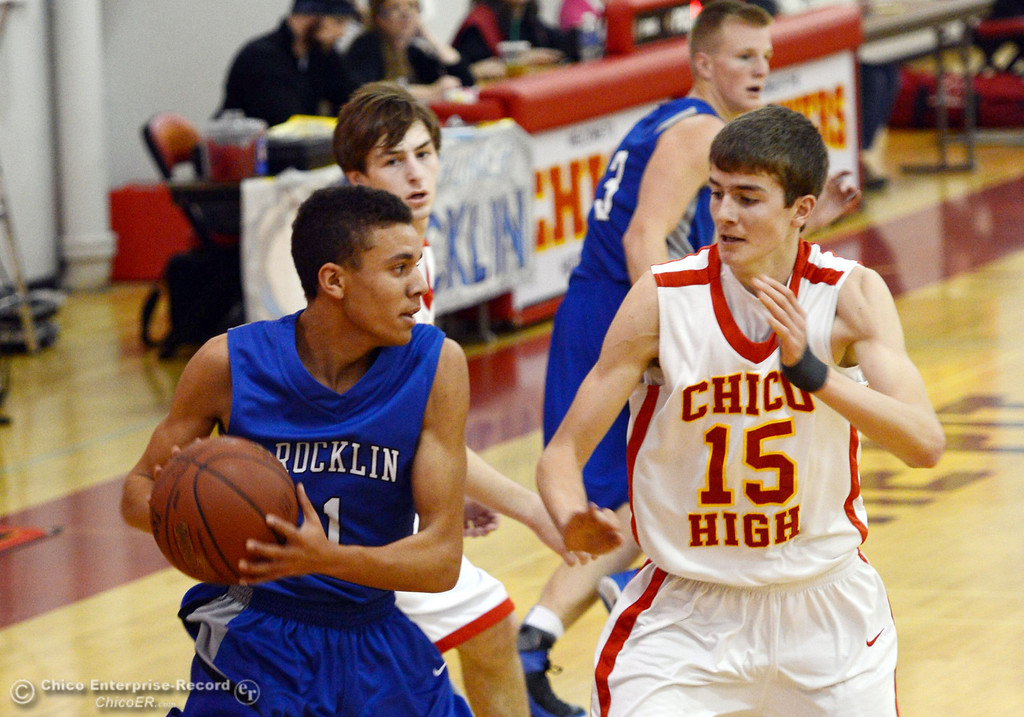 . Chico High\'s #15 Jared Stidham (right) defends against Rocklin High\'s Seth Bradley (left) in the second quarter of their boys basketball game at CHS Tuesday, January 7, 2014 in Chico, Calif.  (Jason Halley/Chico Enterprise-Record)
