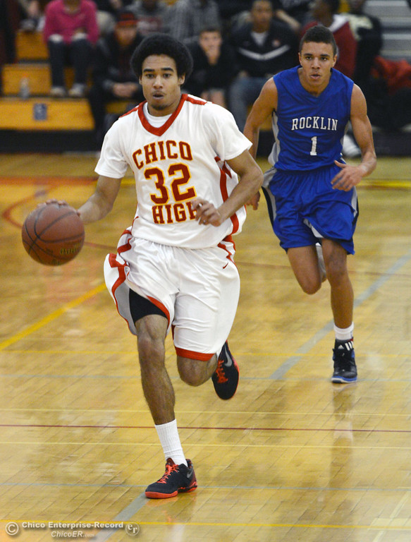 . Chico High\'s #32 Uvonte Person (left) dribbles against Rocklin High\'s #1 Seth Bradley (right) in the second quarter of their boys basketball game at CHS Tuesday, January 7, 2014 in Chico, Calif.  (Jason Halley/Chico Enterprise-Record)