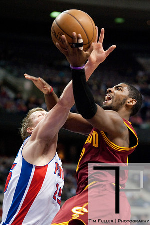 Feb 1, 2013; Auburn Hills, MI, USA; Detroit Pistons shooting guard Kyle Singler (25) fouls Cleveland Cavaliers point guard Kyrie Irving (2) during the first quarter at The Palace. Mandatory Credit: Tim Fuller-USA TODAY Sports
