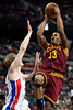 Feb 1, 2013; Auburn Hills, MI, USA; Cleveland Cavaliers small forward Alonzo Gee (33) goes to the basket against Detroit Pistons shooting guard Kyle Singler (25) during the first quarter at The Palace. Mandatory Credit: Tim Fuller-USA TODAY Sports