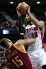 Feb 1, 2013; Auburn Hills, MI, USA; Cleveland Cavaliers power forward Marreese Speights (15) fouls Detroit Pistons center Greg Monroe (10) during the fourth quarter at The Palace. Detroit won 117-99. Mandatory Credit: Tim Fuller-USA TODAY Sports