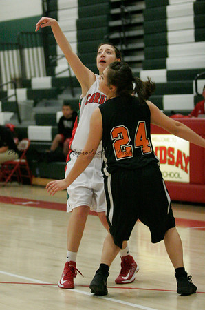Cardinal Ashley Baker shoots over Yesika Juarez of Coalinga on 2-19-13.
