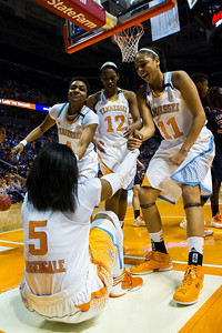 February 21, 2013: forward Cierra Burdick #11, forward Bashaara Graves #12, and guard Kamiko Williams #4 of the Tennessee Lady Volunteers assist teammate point guard Ariel Massengale #5  after she was fouled during the NCAA basketball game between the University of Tennessee  Lady Volunteers and the Auburn Tigers at Thompson-Boling Arena in Knoxville, TN