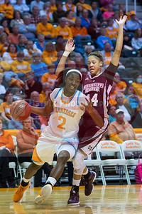 January 28, 2013: forward Jasmine Jones #2 of the Tennessee Lady Volunteers drives past guard Kendran Grant #14 of the Mississippi State Lady Bulldogs during the NCAA basketball game between the University of Tennessee  Lady Volunteers and Mississippi State University Lady Bulldogs at Thompson-Boling Arena in Knoxville, TN