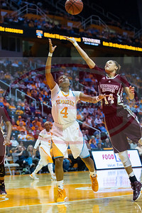January 28, 2013:  guard Kamiko Williams #4 of the Tennessee Lady Volunteers grabs a pass over guard Kendra Grant #14 of the Mississippi State Lady Bulldogs during the NCAA basketball game between the University of Tennessee  Lady Volunteers and Mississippi State University Lady Bulldogs at Thompson-Boling Arena in Knoxville, TN