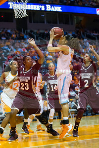 January 28, 2013: guard Meighan Simmons #10 of the Tennessee Lady Volunteers shoots over forward Carnecia Williams #23 of the Mississippi State Lady Bulldogs during the NCAA basketball game between the University of Tennessee  Lady Volunteers and Mississippi State University Lady Bulldogs at Thompson-Boling Arena in Knoxville, TN