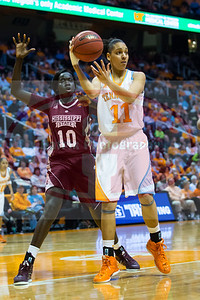January 28, 2013:  forward Cierra Burdick #11 of the Tennessee Lady Volunteers passes the ball as she is guarded by center Martha Alwal #10 of the Mississippi State Lady Bulldogs during the NCAA basketball game between the University of Tennessee  Lady Volunteers and Mississippi State University Lady Bulldogs at Thompson-Boling Arena in Knoxville, TN