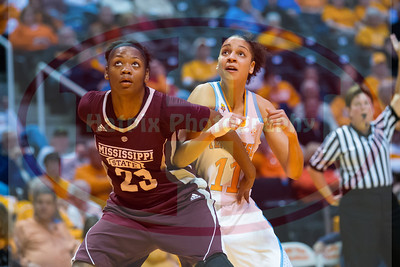 January 28, 2013: forward Cierra Burdick #11 of the Tennessee Lady Volunteers and forward Carnecia Williams #23 of the Mississippi State Lady Bulldogs position for a rebound during  the NCAA basketball game between the University of Tennessee  Lady Volunteers and Mississippi State University Lady Bulldogs at Thompson-Boling Arena in Knoxville, TN