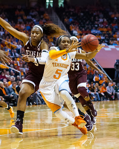 February 28, 2013: point guard Ariel Massengale #5 of the Tennessee Lady Volunteers passes the ball during the NCAA basketball game between the University of Tennessee  Lady Volunteers and the Texas A&M Aggies at Thompson-Boling Arena in Knoxville, TN