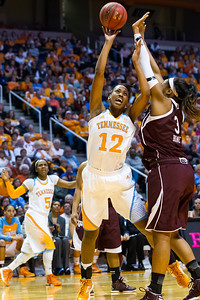 February 28, 2013: forward Bashaara Graves #12 of the Tennessee Lady Volunteers tries to shoot the ball against Kelsey Bone #3 of the Texas A&M Aggies during the NCAA basketball game between the University of Tennessee  Lady Volunteers and the Texas A&M Aggies at Thompson-Boling Arena in Knoxville, TN