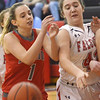 WARREN  DILLAWAY | Star Beacon<br /> Jefferson's Booke Locy (42) battles for the ball with Edgewood's Jenna Johnson (1) on Saturday evening at Jefferson.