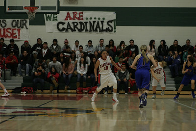 Exeter's Amber Atkinson (1) dribbles up court against Christina Castro (10).