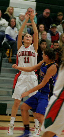 Lindsay  player Megan Salinas (12) shoots over an Exeter defender.