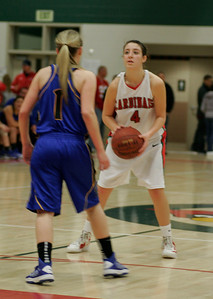 Ashley Baker (4) of Lindsay prepares to shoot against Exeter's Amber Atkinson (1).