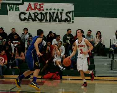 Lindsay Cardinal Gavin Mann (3) move up court against Exeter's Brandon Briones (3) on January 11, 2013.