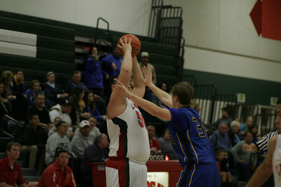Lindsay's Chris Misaalefua (50) puts up a shot against Exeter's Caleb Harden (34). Exeter @ Lindsay - January 11, 2013