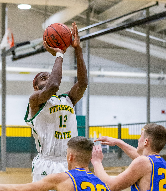 . Fitchburg State\'s Damian Pantoja puts up a shot during a MASCAC postseason tournament quarterfinal game against Worcester State in Fitchburg on Tuesday, Feb. 29, 2019. Fitchburg State won the game, 67-55, to advance to Thursday\'s semifinal round at Westfield State. SENTINEL & ENTERPRISE / GARY FOURNIER