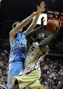 Bernard James (5) shoots the ball over Tyler Zeller (44) of UNC during the FSU vs. UNC basketball game held on Jan. 14th at the Civic Center.