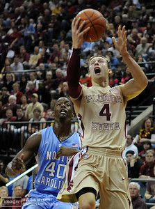 Deividas Dulkys (4) shoots the ball up the court during the FSU vs. UNC basketball game held on Jan. 14th at the Civic Center.