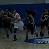 Woodlake attempts a fast break against Farmersville during the Farmersville Girls Basketball tournament.