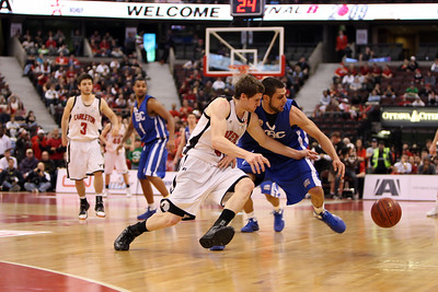 Stewart Turnbull and UBC's Blain Labranche chase a loose ball (MURR8129)