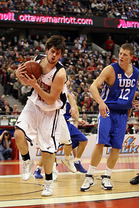 Kevin McCleery gets rebound in front of UBC's Bryson Kool (MURR7898)