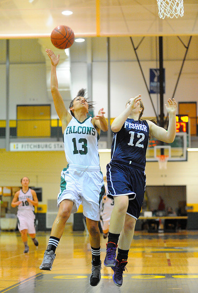 Fitchburg State's Laura Cote lays up the ball while defended by Fisher College's Christine Briggs, Saturday.<br /> SENTINEL & ENTERPRISE / BRETT CRAWFORD